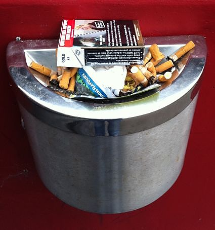 This ashtray has been turned into a trash bin.  This can't happen with Eco-Pole Ashtrays advanced trash-proof design